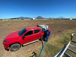 red pick up in a solar park