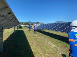 working between solar panels