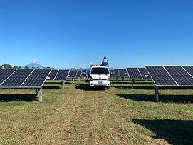 Car between solar panels