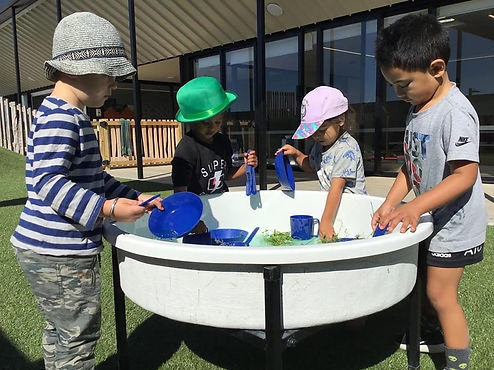 Eduplay Childcare Westgate - children playing in water trough