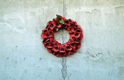 A wreath of synthetic poppies hanging on