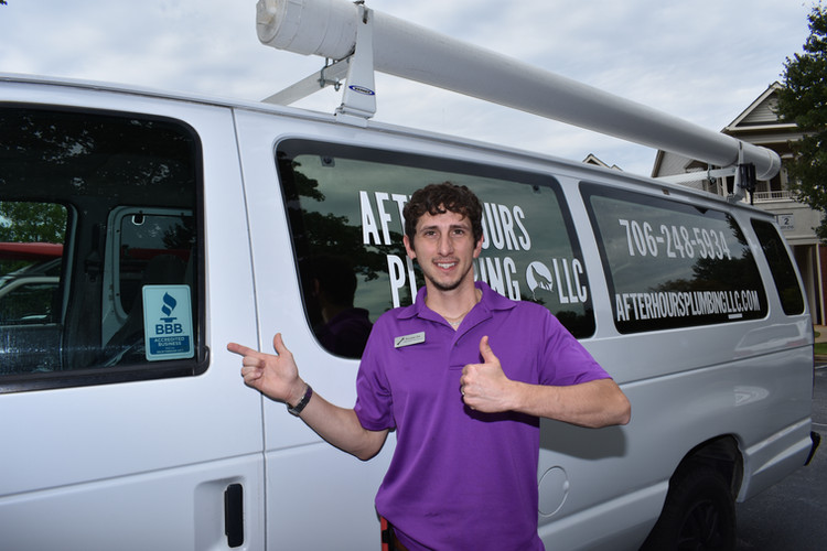 crazy awesome plumber guy in a purple shirt at after hours plumbing llc