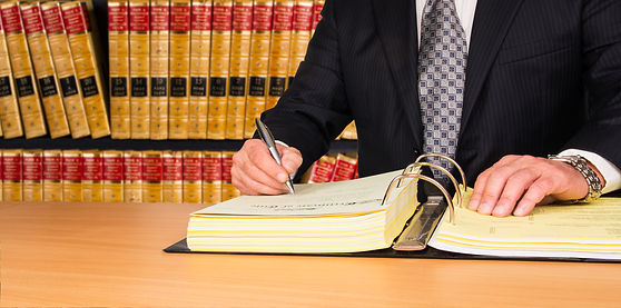 lawyer-signing-legal-documents-52665255.