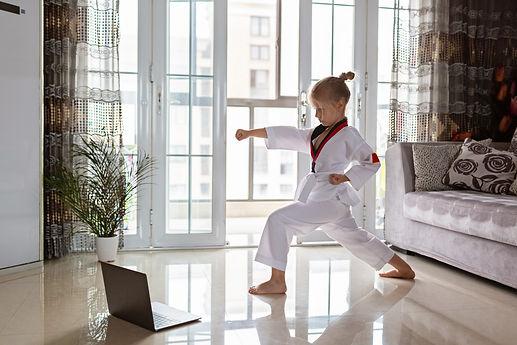 Taekwondo girl in kimono with white belt