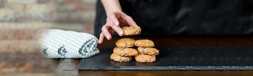 hand piling cookies Vegan Man Bakery lar