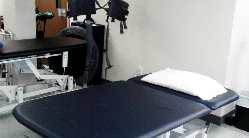 Enable Physiotherapy massage table & our Guldmann GHZ Lift