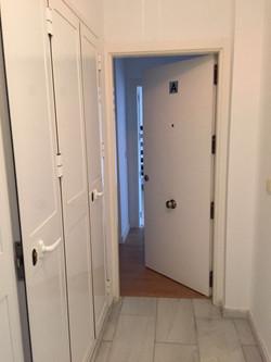 Puerta del apartamento 1A