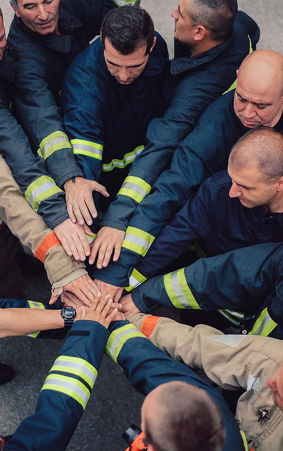 firefighters_hands_stacked.1800x1201.jpg