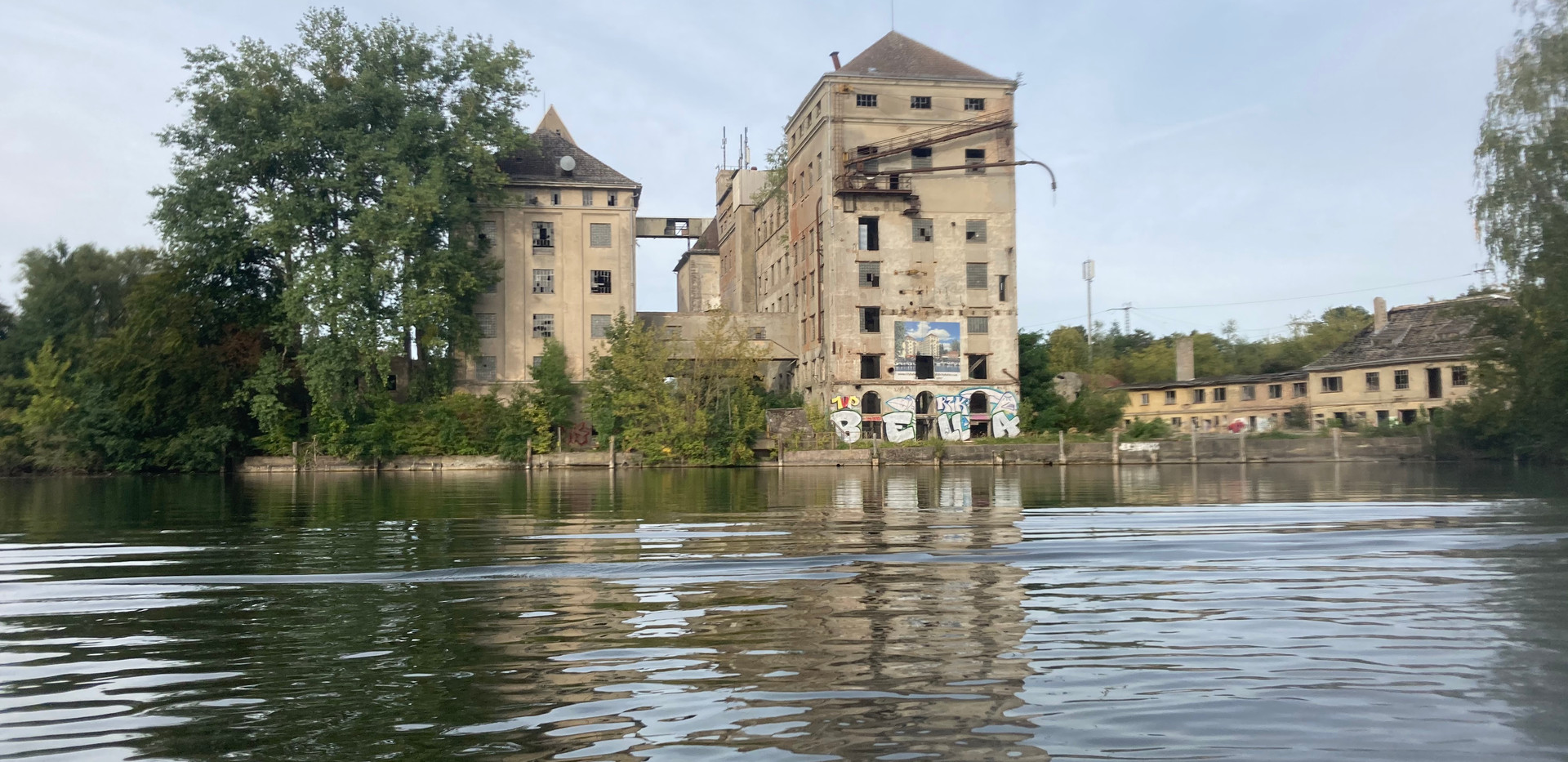 Interesting abandoned factory on the edge of the lake
