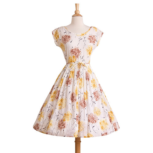 1950s white cotton dress with brown and yellow flowers front view