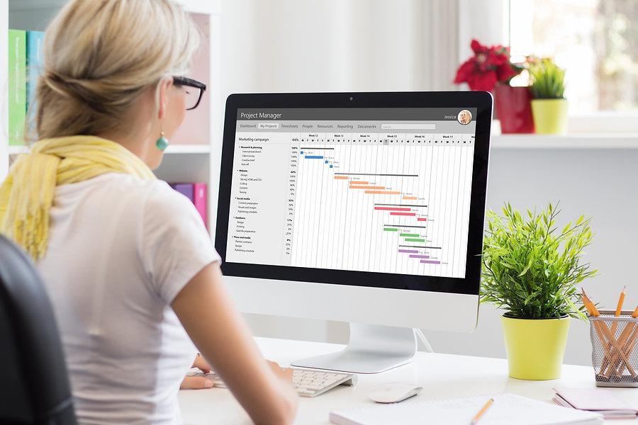 Woman using Gantt chart for project mana