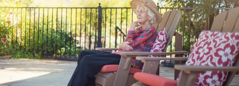 Woman-Outside-sitting-in-Garden-Chair-iS