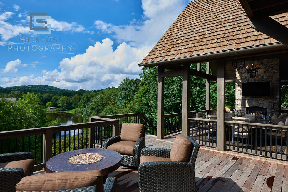Deck overlooking mountains and golf course.