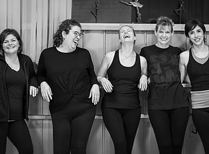 adult dancers smiling and laughing