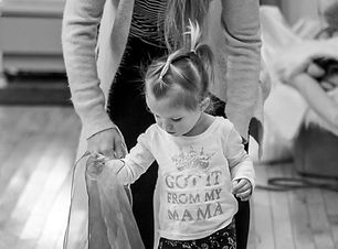 Mother helping her child in dance class