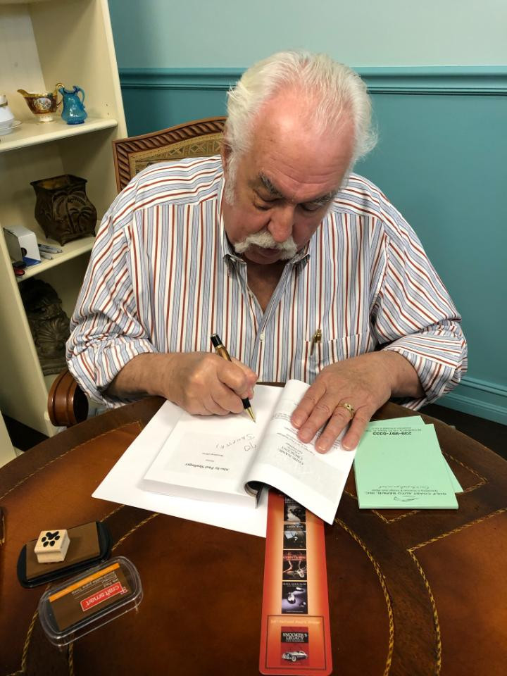 Paul hard at work, pen in hand