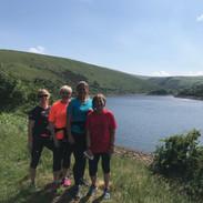 Four Runners enjoying a welcome break at Meldon Dam
