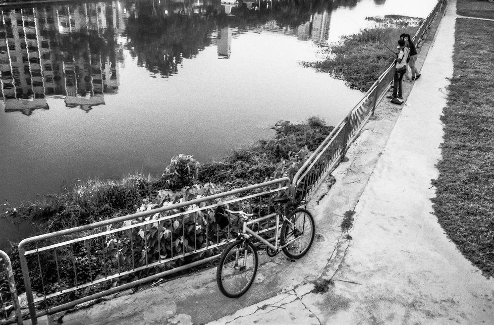 Martin, a construction worker from Bangladesh, fishing in the Geylang river, Singapore
