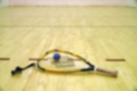 black ball beside yellow and black racquetball racket_edited.jpg
