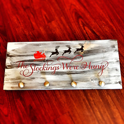 The stockings were hung stocking hanger