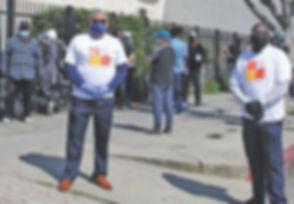 robert and guy at food distribution line
