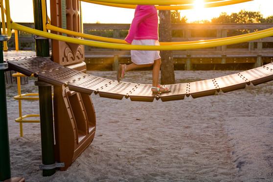 Little Girl Runs on Play Bridge