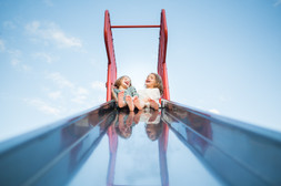 Twin Sisters on Top of Slide