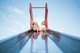 Twin Sisters on Top of Slide