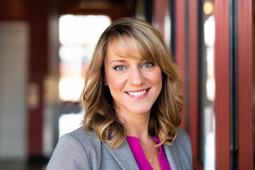 Business woman smiling for a business headshot in Kalamazoo, Michigan