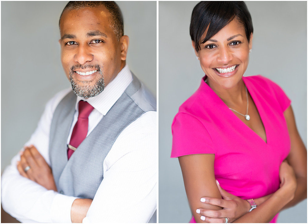 A business man and woman smiling for professional portraits