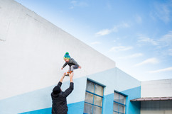 Dad Tosses Son in the Air