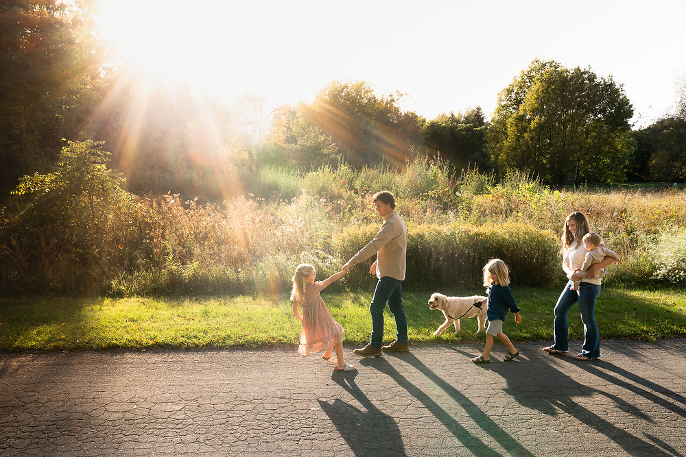 family walking together at sunset