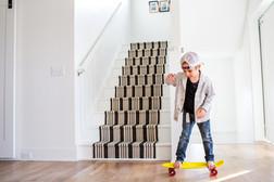 Boy Skateboarding in Home