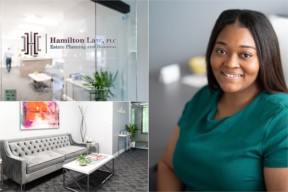Interior of a law office with an employee smiling and looking at the camera