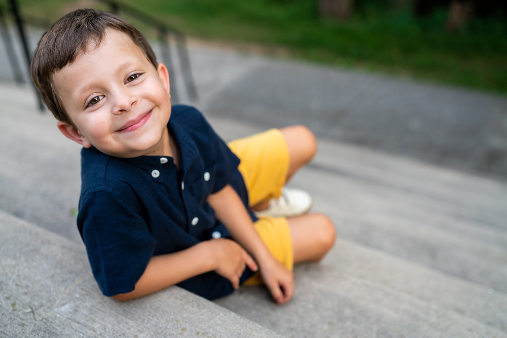 Young boy with brown eyes looking at camera smiling