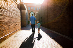 Father and Son Walking in Alley