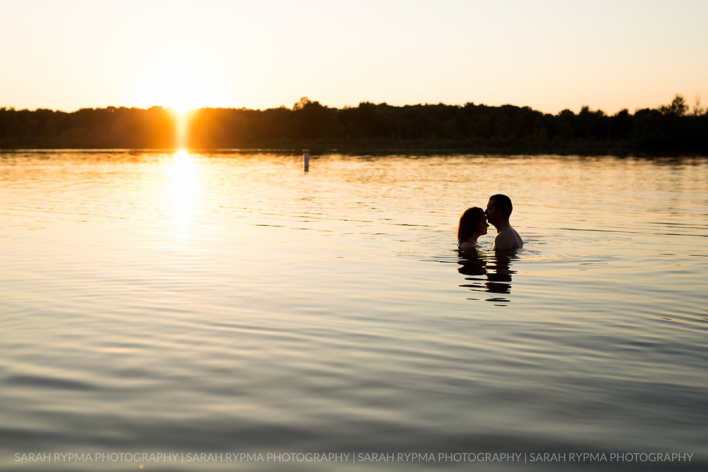 Couple together in a lake at engagement session