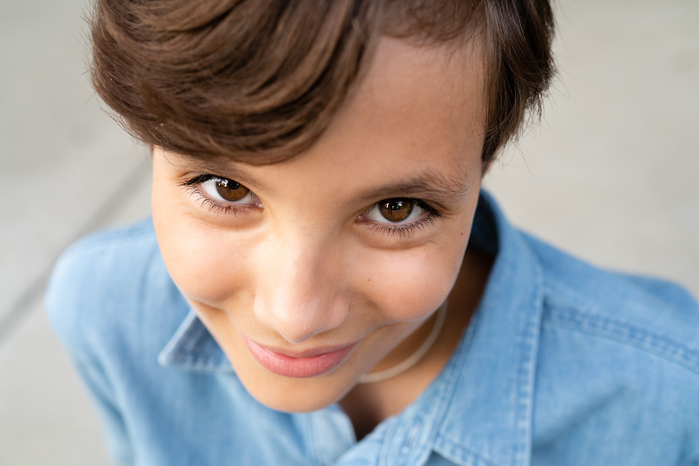 Close up of young girl with big brown eyes