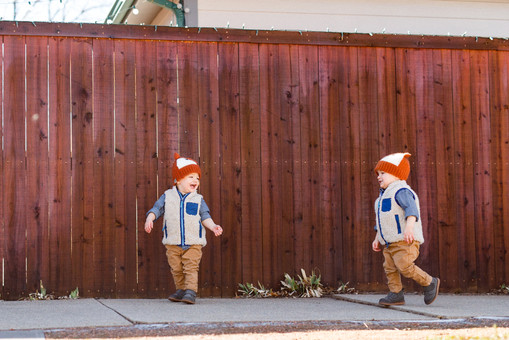 Twin Brothers Walking on Sidewalk