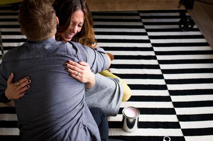Woman Hugs Husband