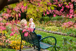 Mother Holds Daughter on Park Bench