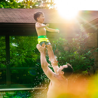 A Father Playing with his Son in a Swimming Pool at Home