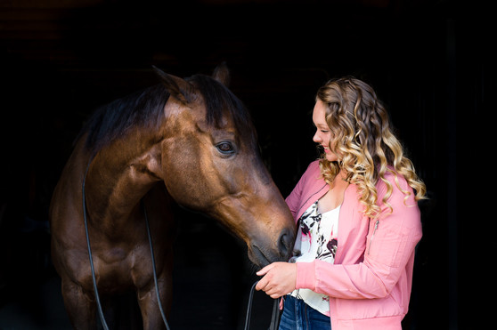Teenage girl with her horse