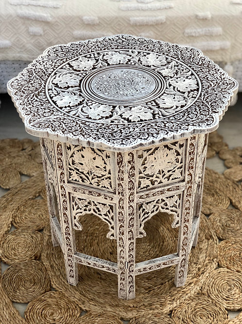 Intricately carved side table