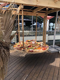 Suspended grazing table