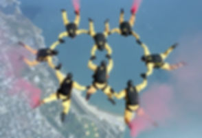 Skydivers Holding Hands