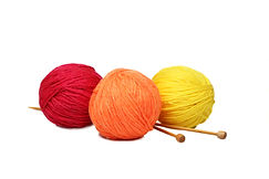 Colorful yarn balls over white backgroun