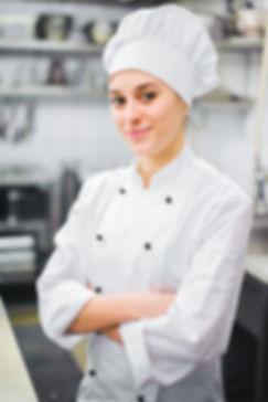 Kokki valkoisessa kokkitakissa