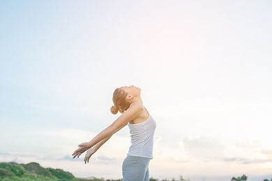 concentrated-woman-stretching-her-arms-w