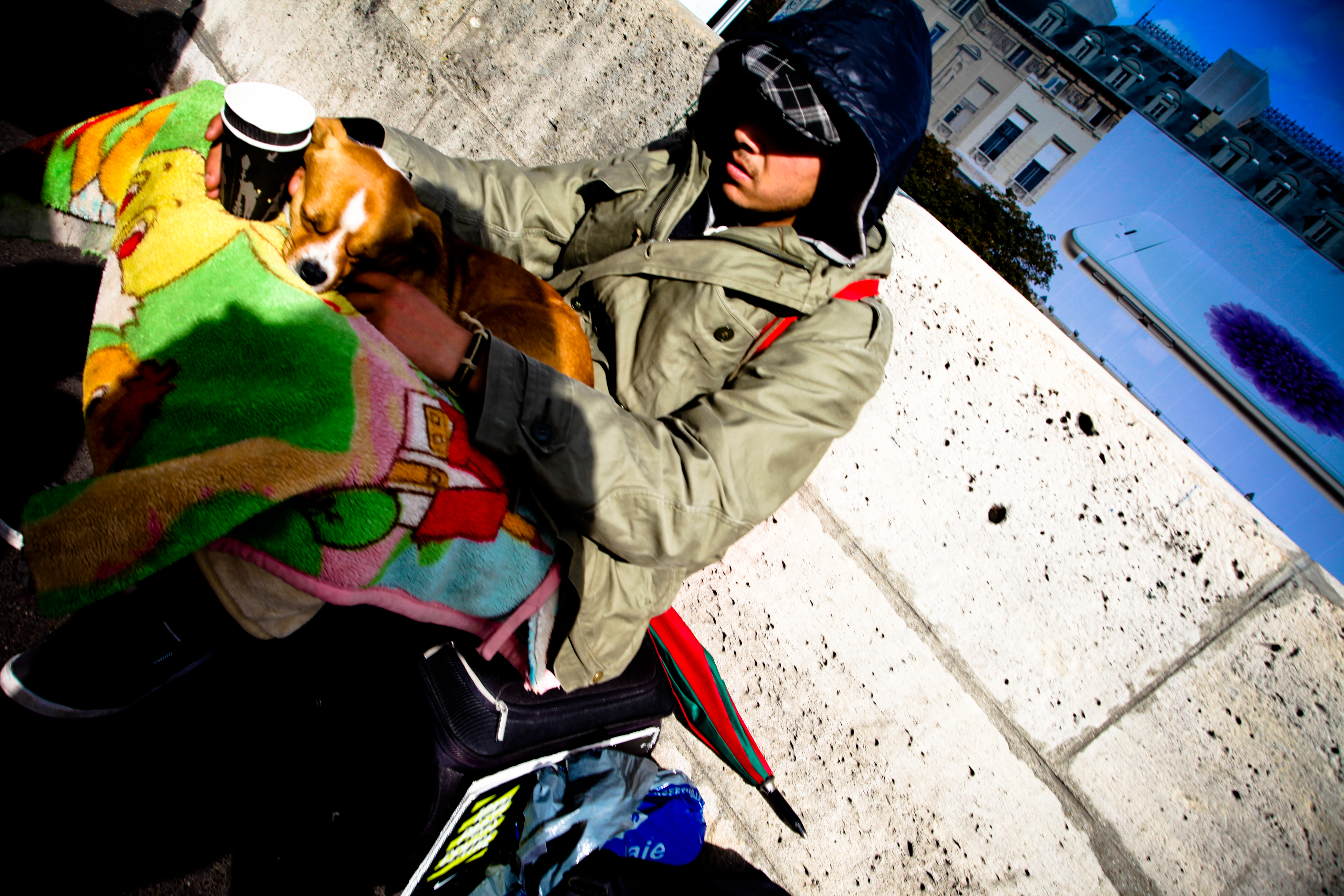 A beggar with his Pup